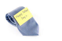 Tie with card tag write happy father day word. Blue neck tie with card tag write happy father day word on a white background Royalty Free Stock Images
