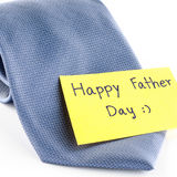Tie with card tag write happy father day word. Blue neck tie with card tag write happy father day word on a white background Royalty Free Stock Image