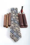 Tie with Cigar and Accessories. A Mens tie with cigars a mouth peace with leather travel liquor cigar case Stock Photo
