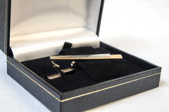 Tie clip in box. Tie clip in a box on a white background royalty free stock photo