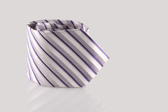 Tie close up. Checkered tie close up on white background Royalty Free Stock Photo