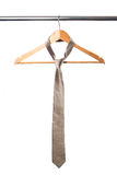 Tie and coat hanger Royalty Free Stock Photos