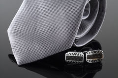 Tie with cuff links. On background Stock Photo