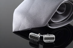 Tie with cuff links. On background Stock Photos