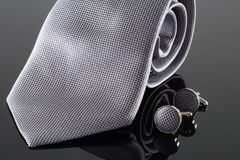 Tie with cuff links stock images
