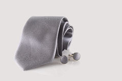 Tie with cuff links. On background Stock Photography