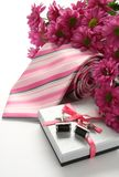 Tie and cuff links with flowers. Over white royalty free stock images