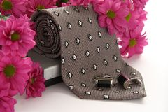 Tie and cuff links with flowers Royalty Free Stock Images