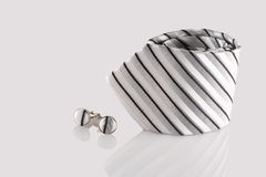 Tie with cuff links. On white background Royalty Free Stock Photos