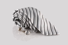 Tie with cufflinks. On white background Royalty Free Stock Photos