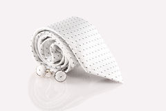 Tie with cufflinks. On white background Stock Photography