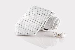 Tie with cufflinks. On white background Royalty Free Stock Images