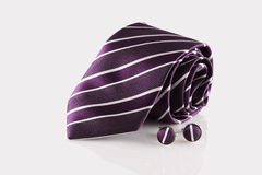 Tie with cufflinks. On white background Royalty Free Stock Photography