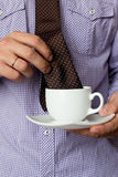 Tie in a cup of tea Royalty Free Stock Photos