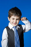Tie, cute little boy portrait over blue chroma background Royalty Free Stock Images