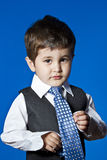 Tie, cute little boy portrait over blue chroma background Stock Image
