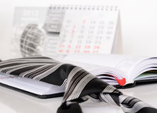 Tie on a diary. Striped tie on an opened diary Stock Photos