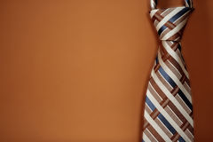 Tie on the dirty orange background Stock Photo