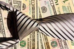Tie and dollars stock images