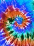 Tie dye. Brightly colored tie dye swirl design stock photography