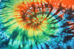 Tie Dye Background. Swirling Tie Dye design in blues, green, yellow, orange, and red Stock Photos