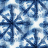 Tie Dye Background. Seamless tie-dye pattern with circles of indigo color on white silk. Hand painting fabrics - nodular batik. Shibori dyeing Stock Images