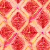 Tie Dye Background. Seamless tie-dye pattern of orange color on white silk. Hand painting fabrics - nodular batik. Shibori dyeing stock illustration