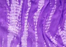 Tie Dye fabric closeup. Closeup detail of purple tie dyed cotton Royalty Free Stock Photos