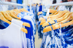 Tie dye shirts and fabric hanging on hangers in a shop Royalty Free Stock Image