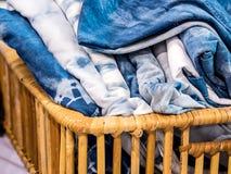 Tie dye T-shirt. Tie dye T-shirt in wicker basket stock photography