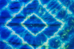 Tie dyed pattern on cotton fabric. Tie dyed pattern on cotton fabric for background royalty free stock photos