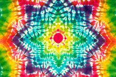 Tie dyed pattern on cotton fabric for background. Royalty Free Stock Photos