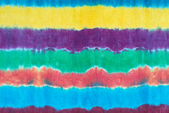 Tie dyed pattern on cotton fabric dip dyed technique abstract background. Royalty Free Stock Photo
