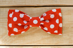 Tie fabric with red polka dots lie on a wooden background Stock Image