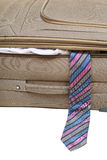 Tie fell out of the ajar suitcase close up Royalty Free Stock Photo