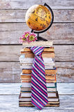 Tie, flowers and globe. Stock Image