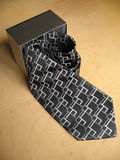 Tie Gift 1. An opened silver gift box with a necktie. Concept : can be use to depict employment, work, or simply as a gift on the special day stock images