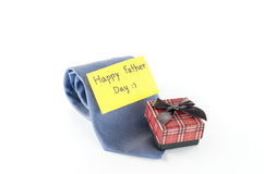 Tie and gift box with card tag write happy father day word. Neck tie and gift box with card tag write happy father day word on a white background Royalty Free Stock Photos