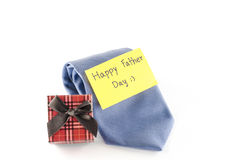 Tie and gift box with card tag write happy father day word. Neck tie and gift box with card tag write happy father day word on a white background Royalty Free Stock Photo