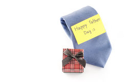 Tie and gift box with card tag write happy father day word. Neck tie and gift box with card tag write happy father day word on a white background Stock Image