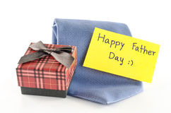 Tie and gift box with card tag write happy father day word. Neck tie and gift box with card tag write happy father day word on a white background Royalty Free Stock Image