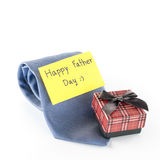 Tie and gift box with card tag write happy father day word. Neck tie and gift box with card tag write happy father day word on a white background Stock Images