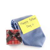 Tie and gift box with card tag write happy father day word. Neck tie and gift box with card tag write happy father day word on a white background Royalty Free Stock Photography