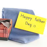 Tie and gift box with card tag write happy father day word. Neck tie and gift box with card tag write happy father day word on a white background Royalty Free Stock Images