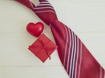 Tie, heart, gift box vintage concept decorative design on a wooden background necktie. Tie heart gift box presents on a wooden background necktie vintage royalty free stock photos