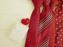 Tie, heart, gift box vintage concept creative romantic composition design on a wooden background necktie. Tie heart gift box presents on a wooden background royalty free stock image