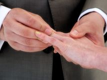 Tie the Knot. Wedding Hands, inserting the band Stock Image