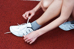 Tie a knot. Woman tied untie his shoes Stock Image