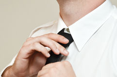 A tie knot. Make a tie knot before going out Stock Photo