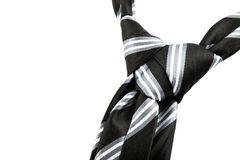 Tie knot with stripes. Elegant casual neck tie knot with stripes on black table Royalty Free Stock Photos